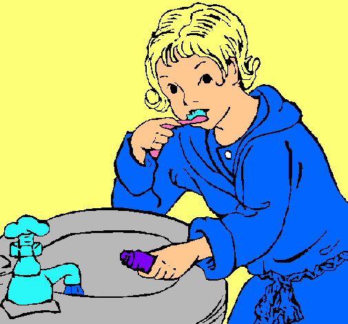 Niño lavándose los dientes