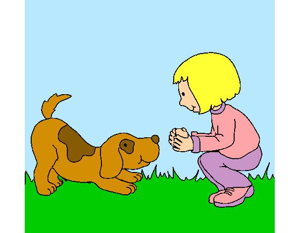 Niña jugando con su perrito