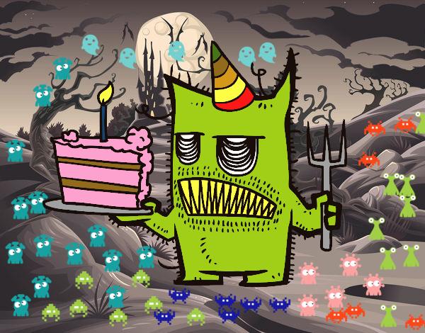 Monstruo con tarta de cumpleaños