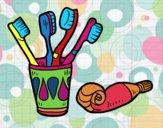 Cepillos y pasta de dientes