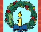 Corona de navidad y una vela
