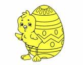 Pollito simpático con huevo de Pascua